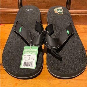 Sanuk beer cozy black sandals.